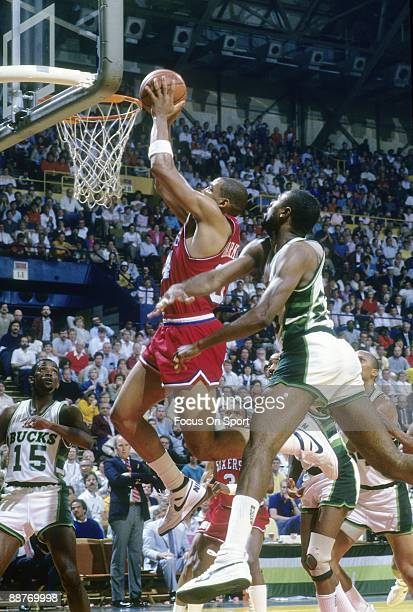 S: Charles Barkley of the Philadelphia 76ers in action goes up to stuff the ball in front of Paul Pressey of the Milwaukee Bucks during a mid circa...