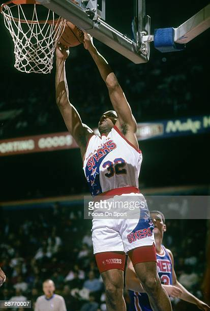PHILADELPHIA PA CIRCA 1990's Charles Barkley of the Philadelphia 76ers in action goes up to stuff the ball against the New Jersey Nets during an...
