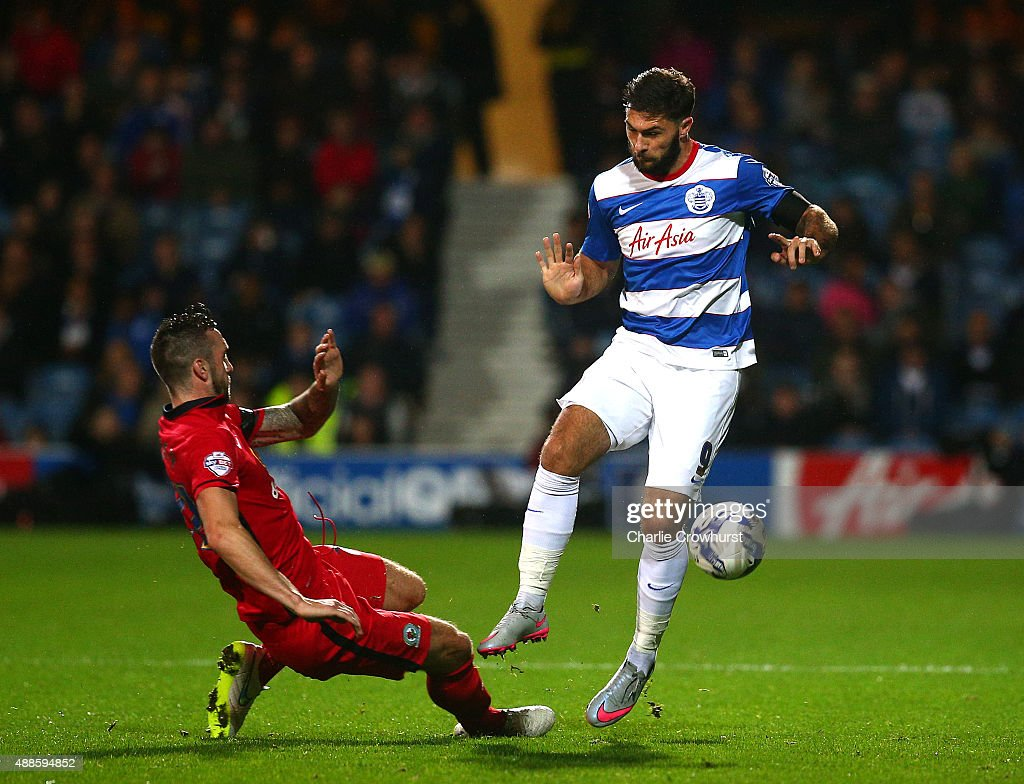 QPR's Charlie Austin is tackled by Shane Duffy of Blackburn during the Sky Bet Championship match between Queens Park Rangers and Blackburn Rangers at Loftus Road on September 16, 2015 in London, England.