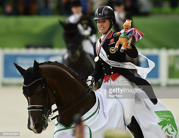 UK's Charlotte Dujardin celebrates her GOLD medal won in the Dressage Grand Prix Special Individual Competition Podium at the Alltech FEI World...