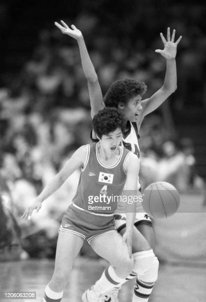 S Cheryl Miller and Korea's Aei-Young Choi , battle for a loose ball during Olympic basketball competition won by the United States 84-87.