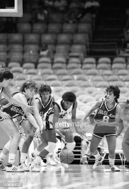 S Cheryl Miller, right, battles and then comes away with the ball by taking it away from Yugoslavia's Polona Dornik and Zagorka Pocekovic , during...