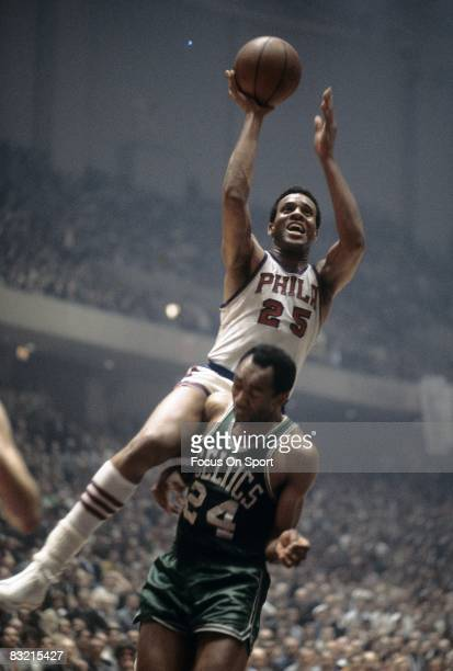 PHILADELPHIA PA CIRCA 1960's Chet Walker of the Philadelphia 76ers shoots over Sam Jones of the Boston Celtics during an mid circa 1960's NBA...