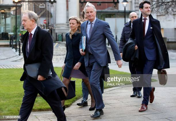 EU's chief Brexit negotiator Michel Barnier arrives with his team at Government Buildings in Dublin on January 27 ahead of his meeting with Ireland's...