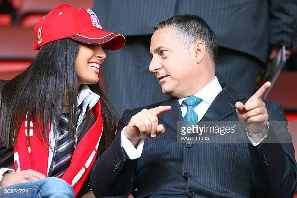 S Chief Executive Samir Al-Ansari and an unidentified woman sit in the directors box before Liverpool took on Chelsea in their UEFA Champions League...