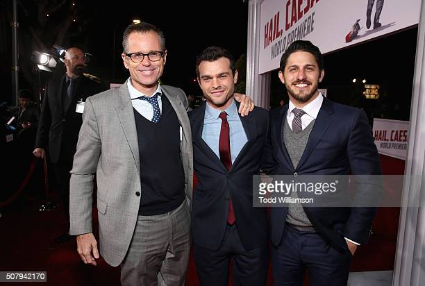 CAA's Chris Andrews Alden Ehrenreich and CAA's Franklin Latt attend Universal Pictures' Hail Caesar premiere at Regency Village Theatre on February 1...