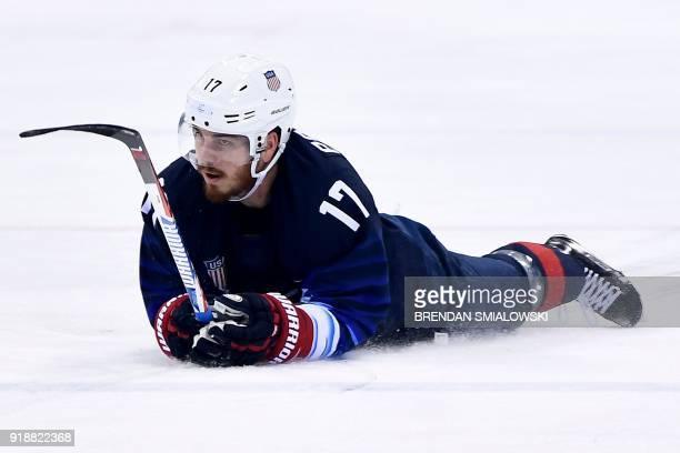 S Chris Bourque lies on the ice in the men's preliminary round ice hockey match between the US and Slovakia during the Pyeongchang 2018 Winter...