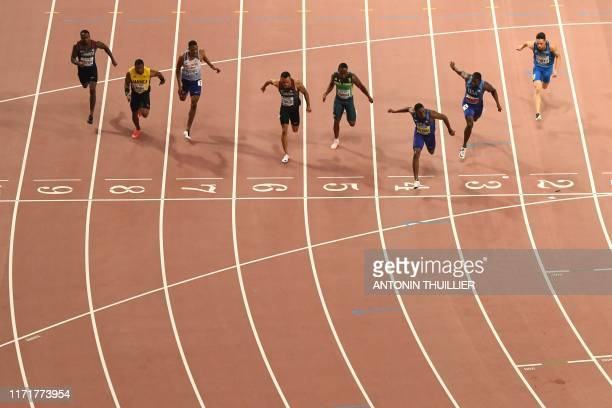 TOPSHOT USA's Christian Coleman crosses the finish line to win the Men's 100m final at the 2019 IAAF World Athletics Championships at the Khalifa...
