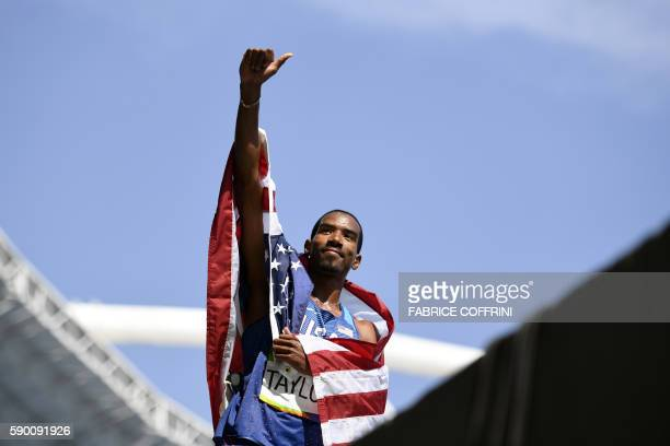 S Christian Taylor celebrates winning the Men's Triple Jump Final during the athletics event at the Rio 2016 Olympic Games at the Olympic Stadium in...