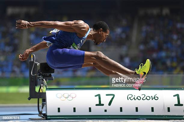 S Christian Taylor competes in the Men's Triple Jump Final during the athletics event at the Rio 2016 Olympic Games at the Olympic Stadium in Rio de...