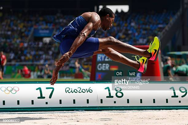 S Christian Taylor competes in the Men's Triple Jump Final during the athletics competition at the Rio 2016 Olympic Games at the Olympic Stadium in...