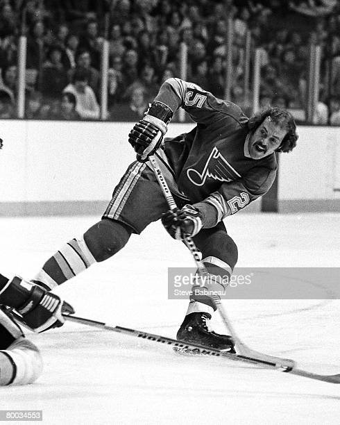 BOSTON MA 1970's Chuck Lefley of the St Louis Blues takes shot in game against the Boston Bruins at Boston Garden