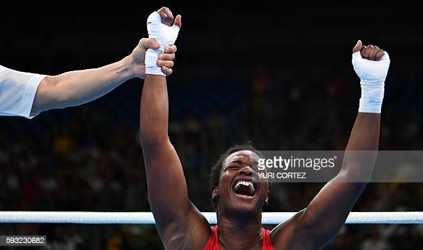 TOPSHOT USA's Claressa Maria Shields reacts after winning against Netherlands' Nouchka Fontijn during the Women's Middle Final Bout at the Rio 2016...