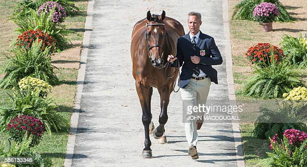 USA's Clark Montgomery leads Loughan Glen to a trot during the first horse inspection of the Equestrian's Eventing phase during the 2016 Rio Olympic...