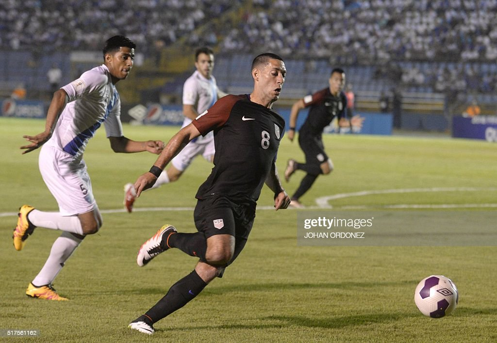 USA's Clint Dempsey (C) drives the ball past Guatamala's Moises Hernandez during their Russia 2018 FIFA World Cup Concacaf Qualifiers' football match, in Guatemala City, on March 25, 2016.