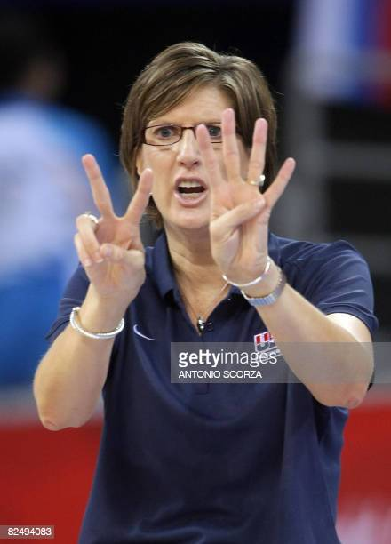 USA's coach Anne Donovan gives instructions to her players during the women's semifinal basketball match Russia against The US of the Beijing 2008...