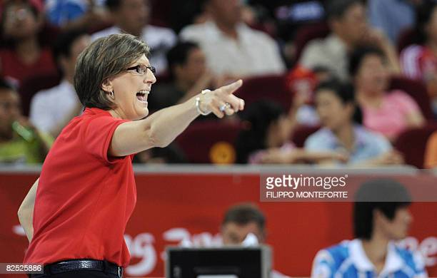 USA's coach Anne Donovan gives instructions to her players during the women's basketball gold medal match Australia against The US of the Beijing...