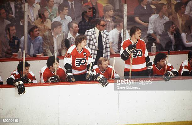 BOSTON MA 1970's Coach Fred Shero of the Philadelphia Flyers along with players Jimmy Watson Dave Hoyda Bobby Clarke Bob Kelly Bill Barber and Reggie...