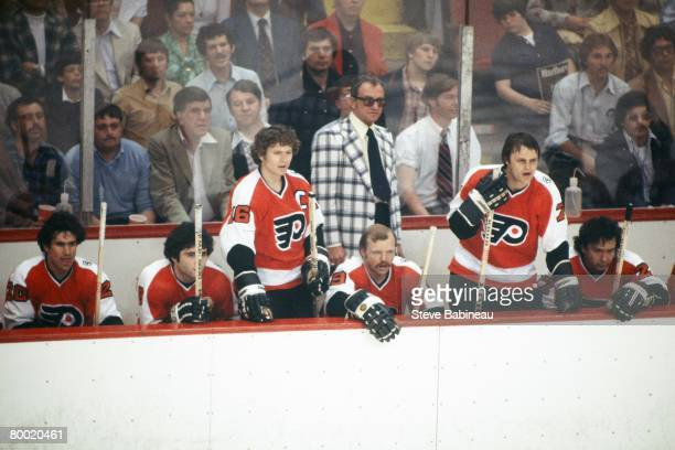 BOSTON MA 1970's Coach Fred Shero of the Philadelphia Flyers along with players Jimmy Watson Dave Hoyda Bobby Clarke Bob Kelly Bill Barber and Reggie...
