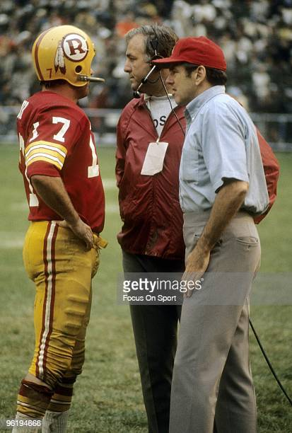 C CIRCA 1970's Coach George Allen of the Washington Redskins talks with his quarterback Billy Kilmer from the sideline during a circa 1970s NFL game...