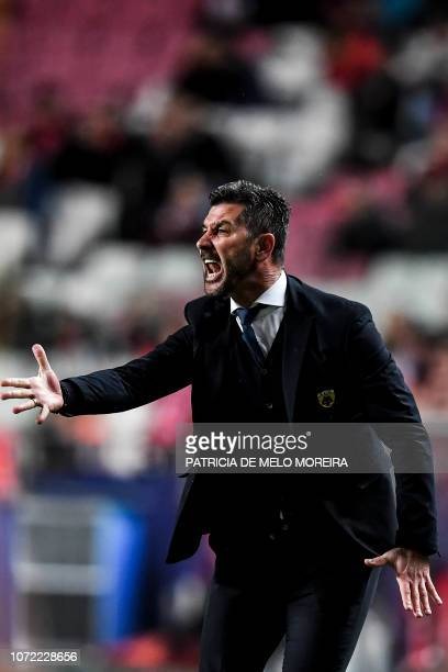 AEK's coach Marinos Ouzounidis gestures from the sideline during the UEFA Champions League group E football match between SL Benfica and AEK Athens...