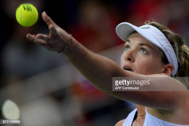 USA's Coco Vandeweghe serves the ball to Belarus' Aryna Sabalenka on November 12 2017 in Minsk during their Fed Cup final tennis match between...