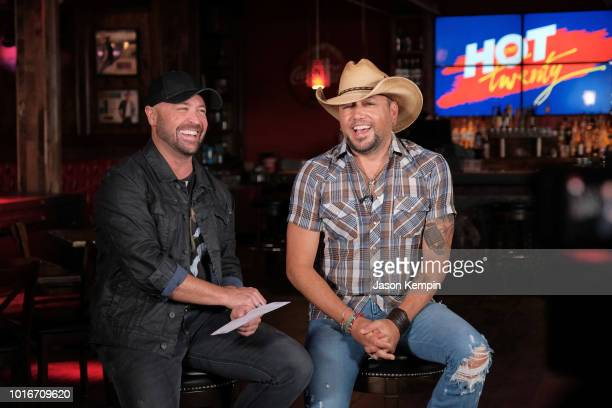 CMT's Cody Alan and country artist Jason Aldean are seen at Jason Aldean's Kitchen Rooftop Bar on August 9 2018 in Nashville Tennesse