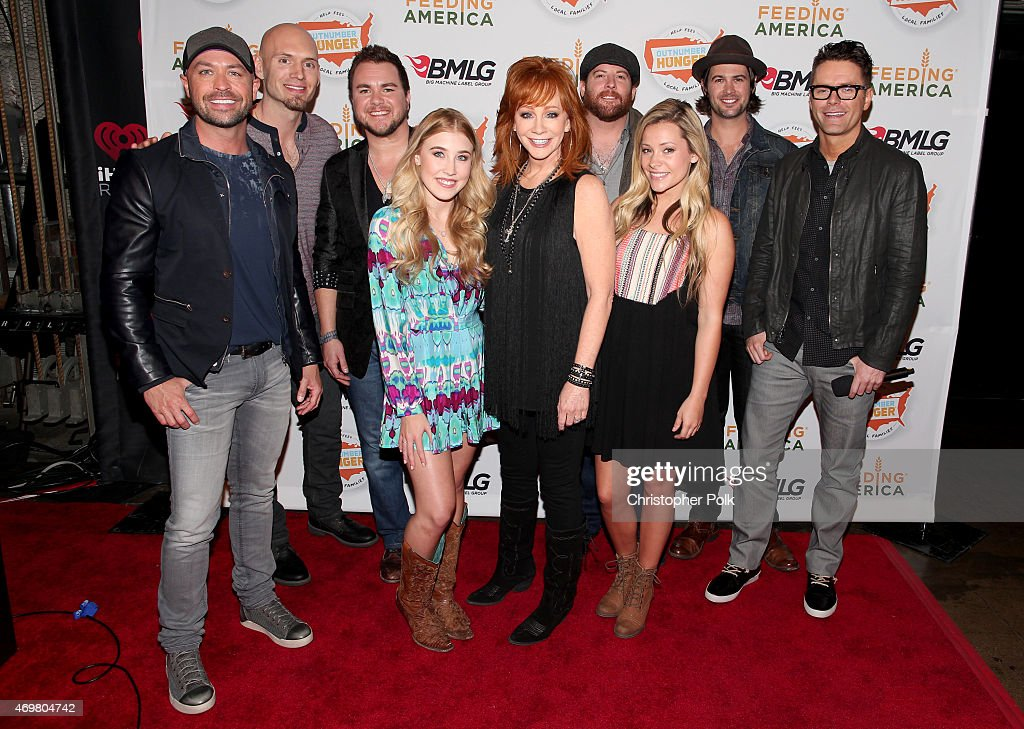 CMT's Cody Alan, Jon Jones, Mike Eli, Madison Marlow, Reba McEntire, Taylor Dye, James Young, Chris Thompson and iHeart's Bobby Bones at the 'Reba and Friends Outnumber Hunger' concert event on Tuesday, March 31, 2015 in Burbank, California. Tune in starting April 17, 2015 to the 'Reba and Friends Outnumber Hunger' concert event, which officially launches the fourth annual Outnumber Hunger campaign. This collaboration between General Mills, Big Machine Label Group and Feeding America highlights the issue of hunger in America and helps provide meals to people and families in need. Reba headlines along with performances by Tim McGraw, Rascal Flatts, Florida Georgia Line, Eli Young Band and Maddie & Tae. Visit OutnumberHunger.com for local listings.