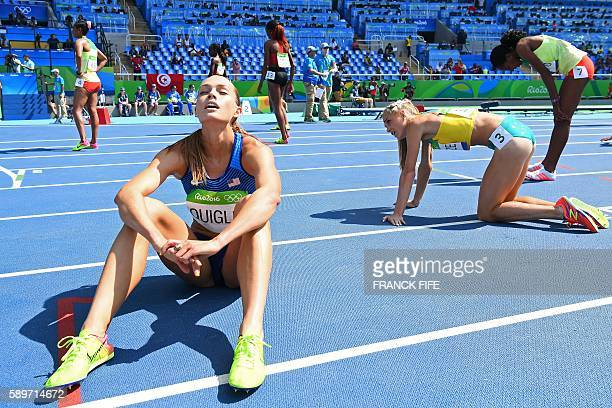TOPSHOT USA's Colleen Quigley Australia's Genevieve Lacaze and Ethiopia's Etenesh Diro react at the end of the Women's 3000m Steeplechase Final...