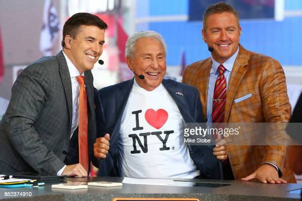 ESPN's College GameDay Analysts Chris Fowler Lee Corso and Kirk Herbstreit pose for a photo during ESPN's College GameDay show at Times Square on...