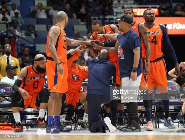 S Company head coach Michael Cooper talks with his team during half time during the BIG3 Playoffs at Smoothie King Center on August 25, 2019 in New...