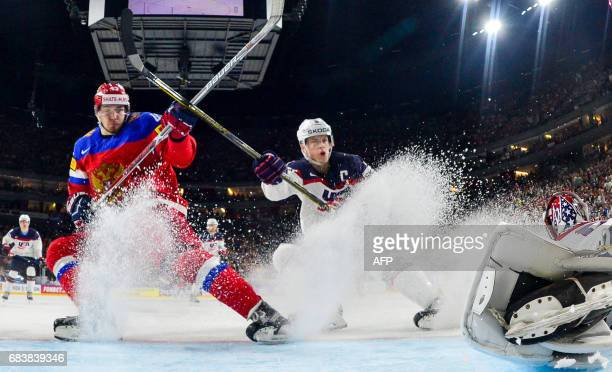 TOPSHOT USA's Connor Murphy and Russia's Valerie Nichushkin vie during the IIHF Men's World Championship Ice Hockey match between Russia and USA in...