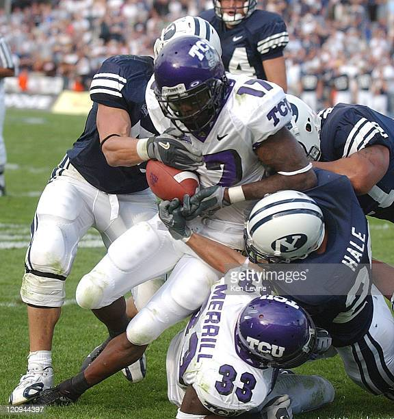 TCU's Corey Rodgers is tackled by BYUs Chris Hale just as he reaches the goalline in overtime Rodgers fumbled the ball but was ruled over the goal...