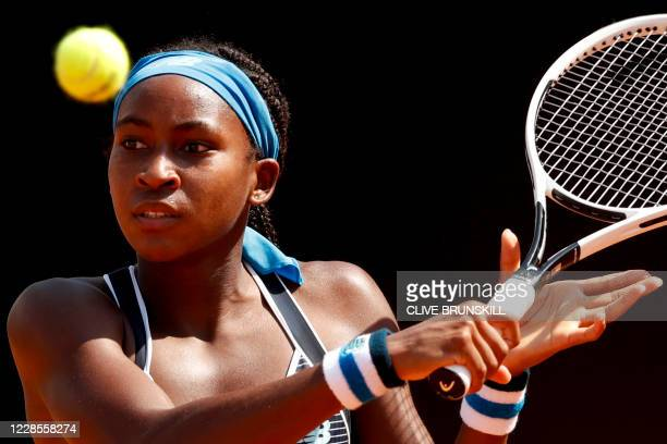 S Cori Gauff plays a backhand to Spain's Garbine Muguruza on day four of the Women's Italian Open at Foro Italico on September 17, 2020 in Rome,...