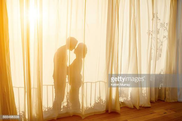 40's couple in apartment - hot women making out stock pictures, royalty-free photos & images