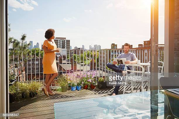 40's couple in apartment - balcony stock pictures, royalty-free photos & images