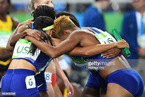 USA's Courtney Okolo Natasha Hastings Allyson Felix and Phyllis Francis celebrate winning the Women's 4x400m Relay Final during the athletics event...