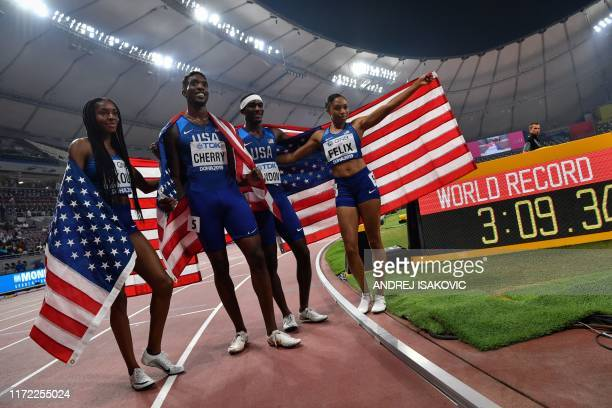 USA's Courtney Okolo USA's Michael Cherry USA's Wilbert London and USA's Allyson Felix celebrate after setting a world record in the Mixed 4 x 400m...