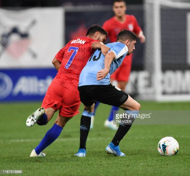 USA's Cristian Roldan vies for the ball with Uruguay's Federico Valverde during the International Friendly football match between the United States...