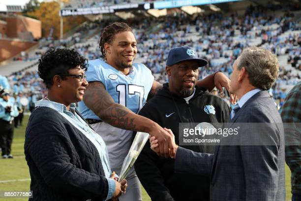 UNC's Dajaun Drennon shakes hands with athletic director Bubba Cunningham during Senior Day pregame activities during the North Carolina Tar Heels...