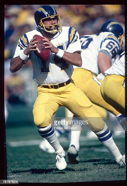 SAN DIEGO CA CIRCA 1980's Dan Fouts of the San Diego Chargers drops back to pass against the Seattle Seahawks in a circa mid 1980's NFL game at Jack...