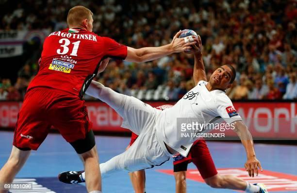 TOPSHOT PSG's Daniel Narcisse and Veszprem's Blaz Blagotinsek vie for the ball during Handball EHF Champions League final Four semi final match...