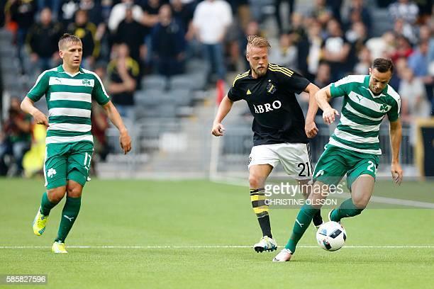 AIK´s Daniel Sundgren vies for the ball with Panathinaikos Giandomenico Mesto and Robin Lod during the qualifying football match of the UEFA Europa...