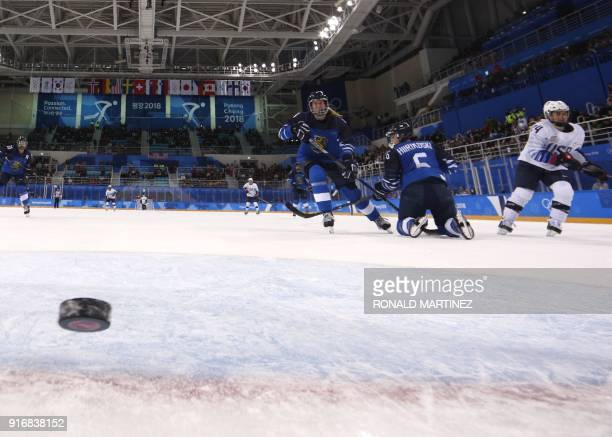 S Danielle Cameranesi looks on as the puck croses into the goal in the women's preliminary round ice hockey match between Finland and the US during...