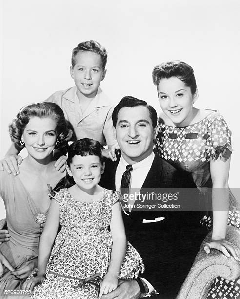 CBSTV's Danny Thomas next to his TV bride Marjorie Lord holds winsome Angela Cartwright on his lap while Rusty Hamer and Sherry Jackson smile over...