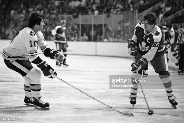 BOSTON MA 1970's Darryl Sittler of the Toronto Maple Leafs and Carol Vadnais of the Boston Bruins skates at Boston Garden