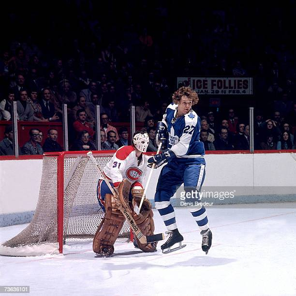 Darryl Sittler of the Toronto Maple Leafs screens goalie Michel Larocque of the Montreal Canadiens.