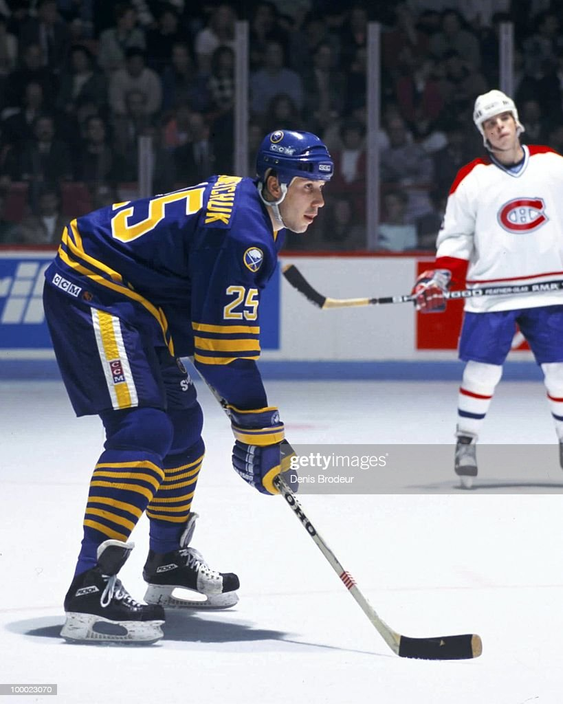 MONTREAL - 1980's: Dave Andreychuk #25 of the Buffalo Sabres skates against the Montreal Canadiens in the late 1980's at the Montreal Forum in Montreal, Quebec, Canada.