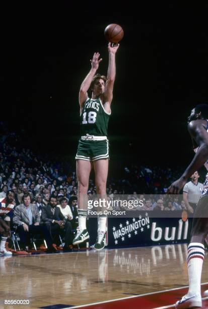 BALTIMORE MD CIRCA 1970's Dave Cowens of the Boston Celtics shoots in front of Elvin Hayes of the Washington Bullets during a early circa 1970 NBA...