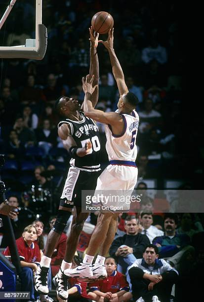 BALTIMORE MD CIRCA 1990's David Robinson of the San Antonio Spurs in action blocking the shot of Juwan Howard of the Washington Bullets during a mid...